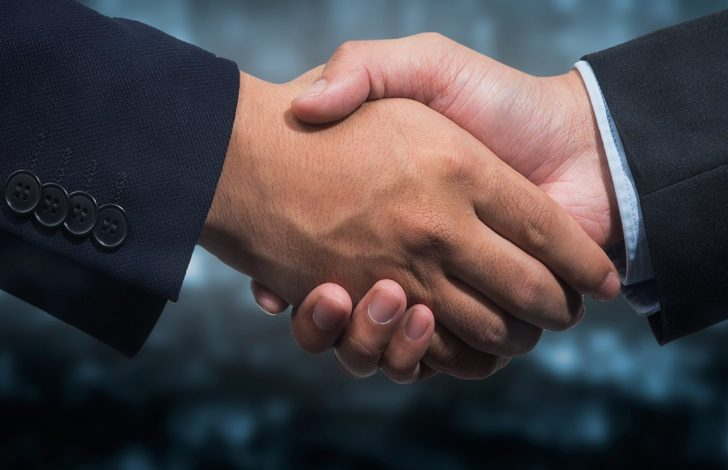 two business brokers shaking hands