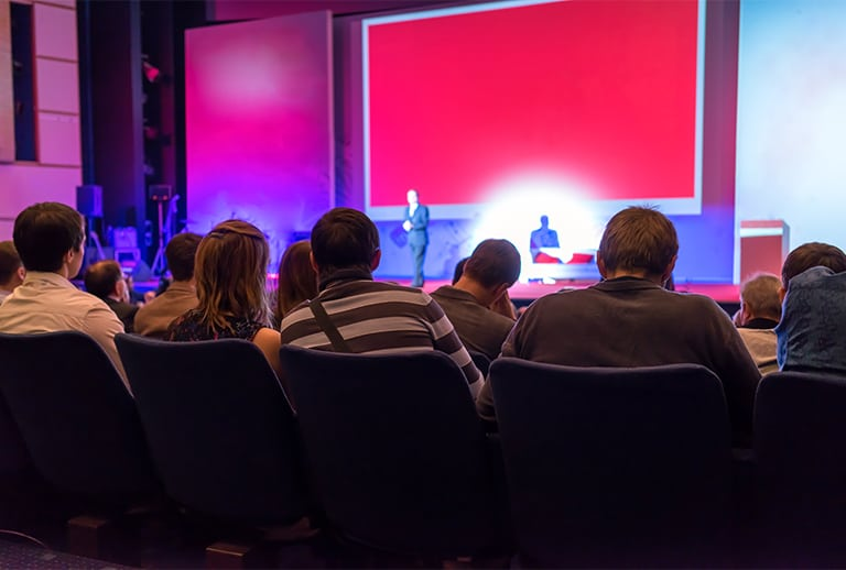 people sitting down at conference