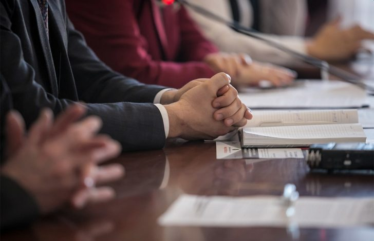 close up of two business man folding there hands
