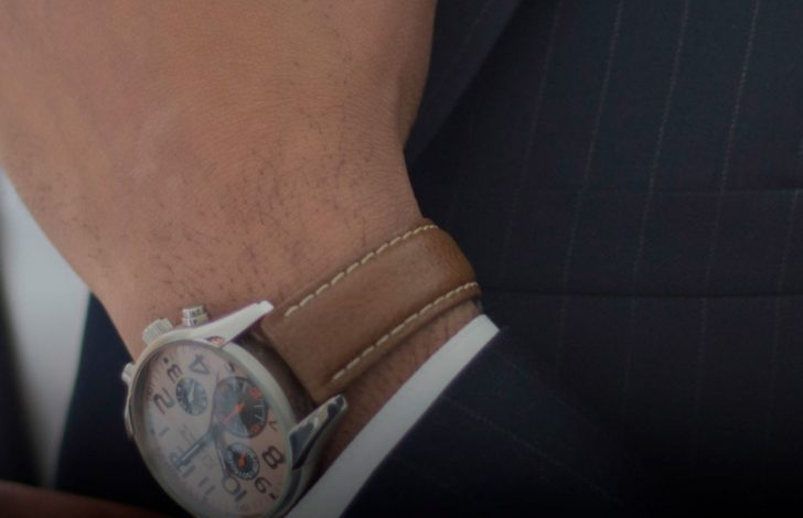 close up of a watch on a mans wrist